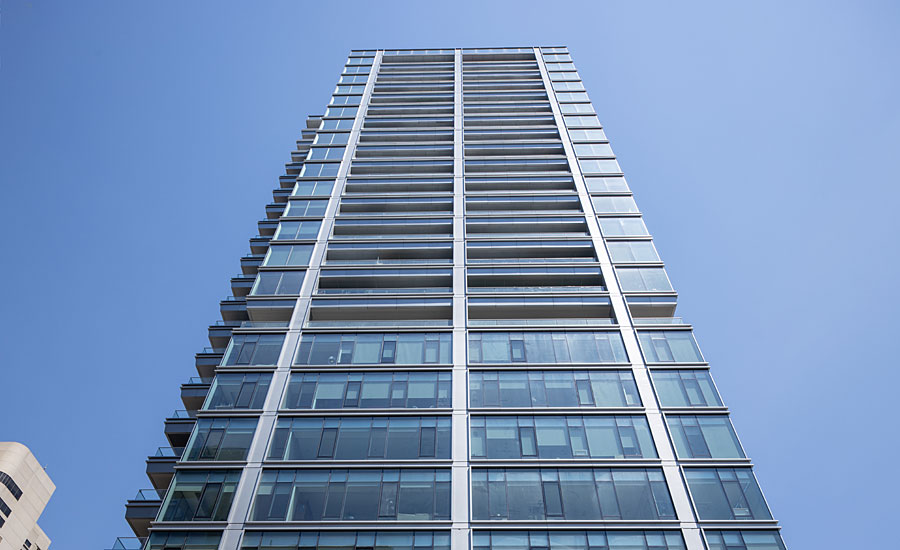 Franklin Tower Re-Clad in Glass and Metal with Wood Grain Finishes